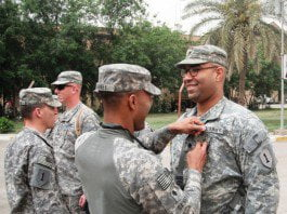 Lt. Col. Andrew C. Gainey presents the Army Achievement Medal to Spc. Tyree D. Traylor.