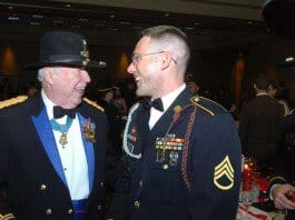 Retired Lt. Col. Bruce Crandall, Medal of Honor recipient, talks with Staff Sgt. Kenneth Rohr during the 1st Squadron, 6th Cavalry Regiment, ball.