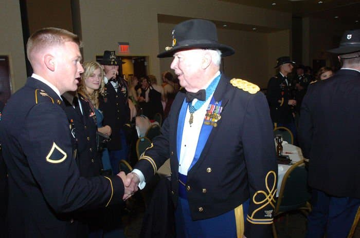 Retired Lt. Col. Bruce Crandall, Medal of Honor recipient, talks with Pfc. James Young during the 1st Squadron, 6th Cavalry Regiment, ball.