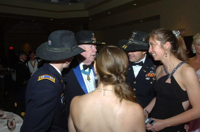 Retired Lt. Col. Bruce Crandall, Medal of Honor recipient, talks with officers and their spouses during the 1st Squadron, 6th Cavalry Regiment, ball.