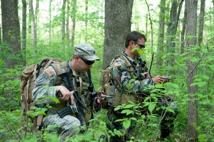 Soldiers with 2nd Battalion, 19th Special Forces Group check their course with compasses during a foot patrol while training at Camp Atterbury Joint Maneuver Training Center, Ind.