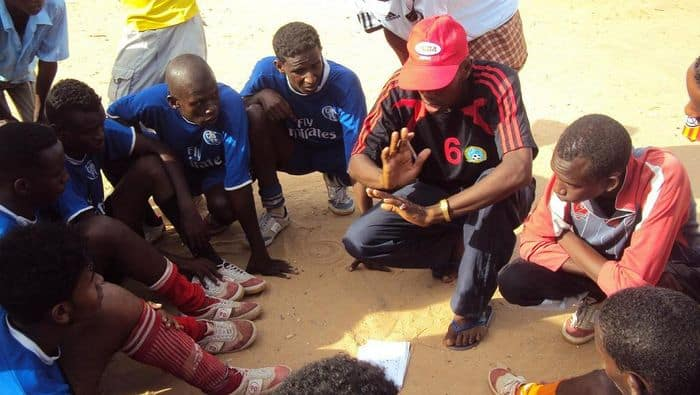 Coach Hassan Ali Roble explains to his young boys