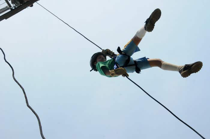 Kameran Jones, from Greenwood, Ind., conquers the rappel tower at Camp Atterbury Joint Maneuver Training Center, Ind.