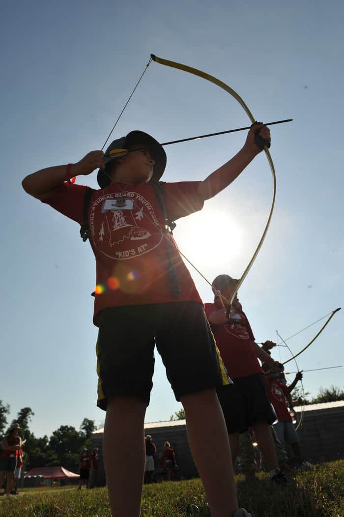 Connor James, of New Haven, Ind., takes aim during the archery event during Kids Annual Training at Camp Atterbury.