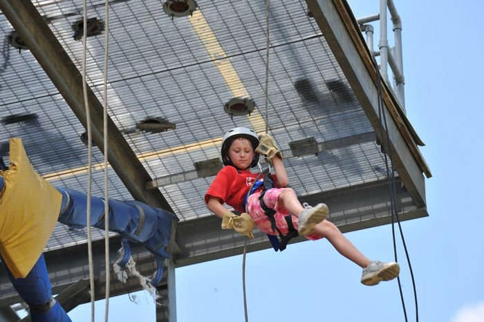 Rayna Goodin, of Indianapolis, rappels down a 45foot rappel tower during Kids Annual Training at Camp Atterbury Joint Maneuver Training Center, Ind..