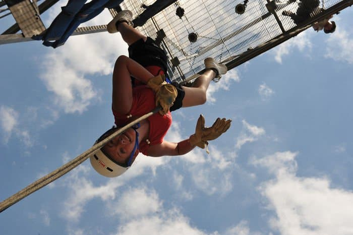 Ally Roff, of Southport, Ind., rappels inverted down a 45foot rappel tower during Kids Annual Training at Camp Atterbury.