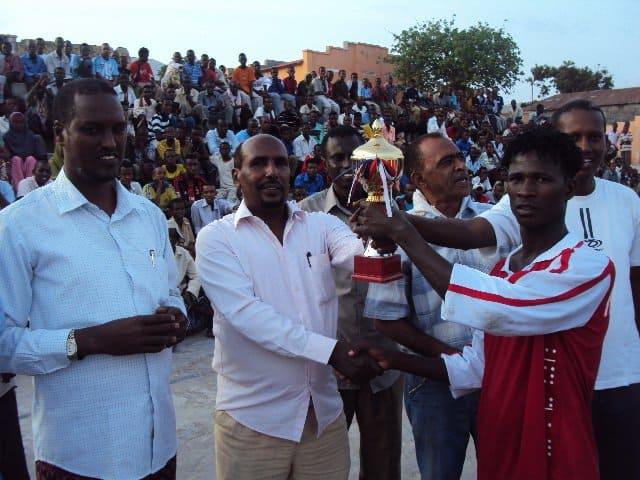 captain receives the trophy