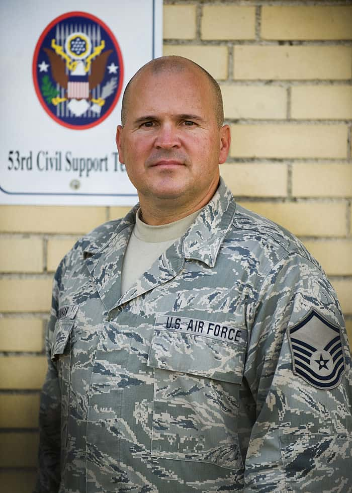 Senior Medic, Master Sgt. James Stranahan, of Shelburn, Ind., 53rd Civil Support Team, ran from the stands to assist the injured after the stage collapsed at the Indiana State Fair.