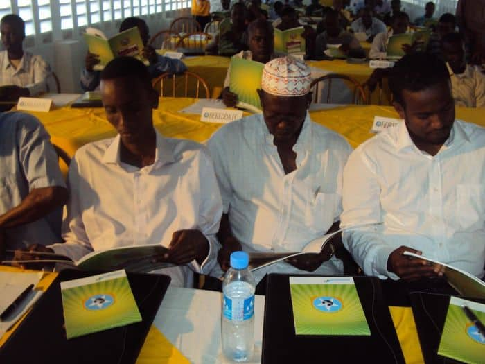 Soccer club presidents read the SFF activity book