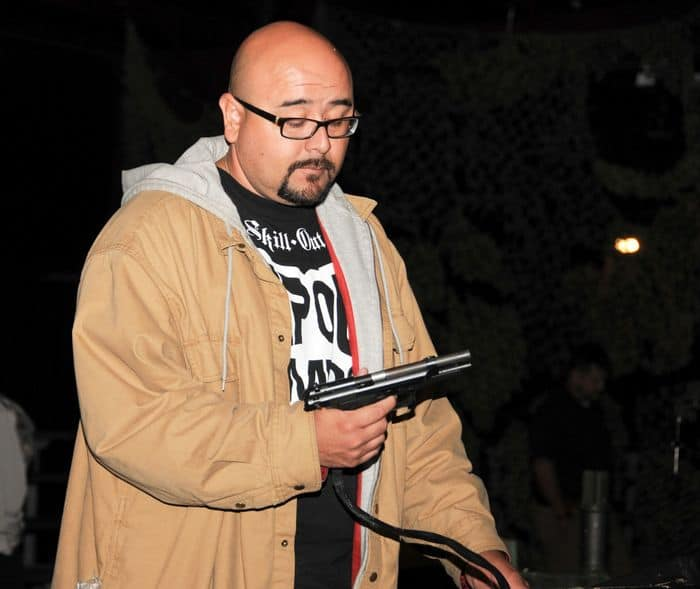 Juan Gonzalez, an El Paso, Texas native and mechanic for Technica, LLC, familiarizes himself with an M9 pistol in weapons training.