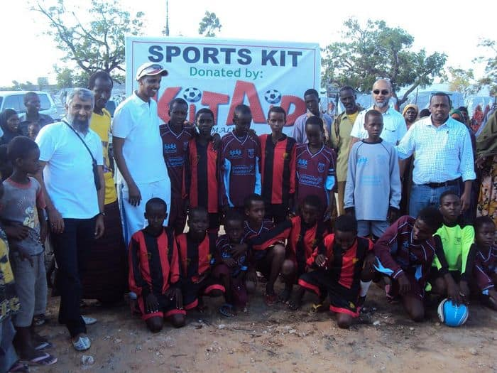Somali NOC and other officials stand among children before match kicks off