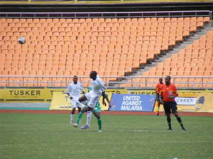 rwanda player leaps over uganda