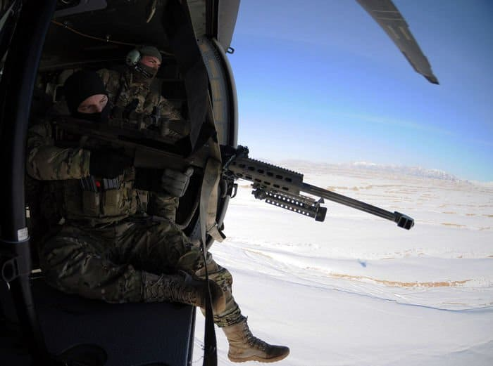 U.S. Army Cpl. William Hopkins, a spotter, takes aim at a target with the Barrett .50 Cal., as Sgt. Lucas Cordes watches.