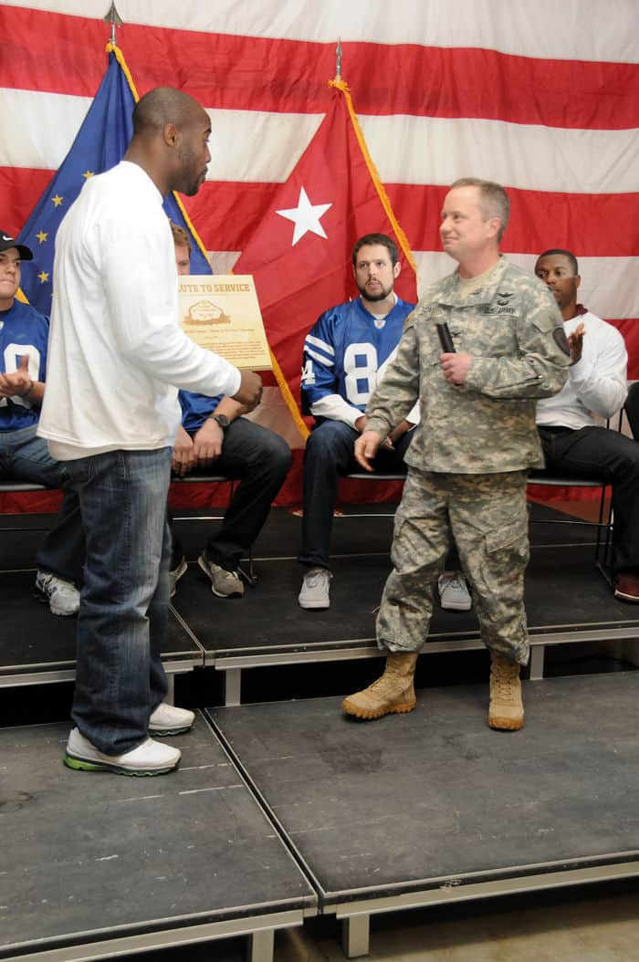 Will Witherspoon, Tennessee Titans offensive linebacker, accepts a plaque from Col. Todd Townsend, Camp Atterbury post commander, for all the NFL players who attended the NFL Salute to Service military appreciation event.