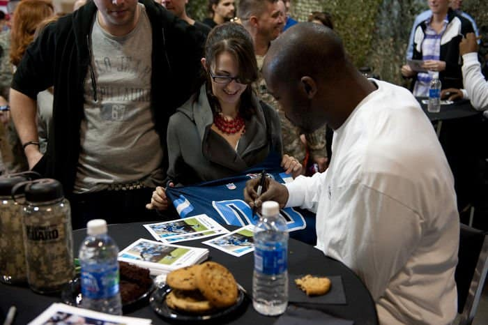 Tennessee Titans Offensive Linebacker Will Witherspoon autographs a jersey for Meagan Lewis, of Spencer County, Tennessee, at the National Football League Salute to Service event, Camp Atterbury Joint Maneuver Training Center, Ind.