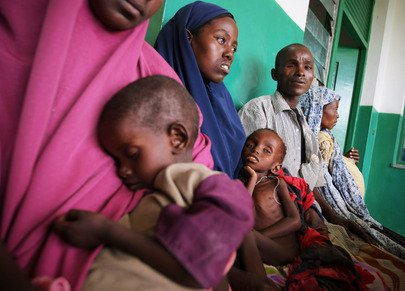 Parents wait with their malnourished and dehydrated children in a corridor at Banadir Hospital in the Somali capital Mogadishu.