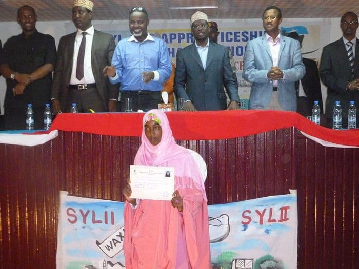 Somali President, Sheik Sharif Sheik Ahmed and a graduating female student.