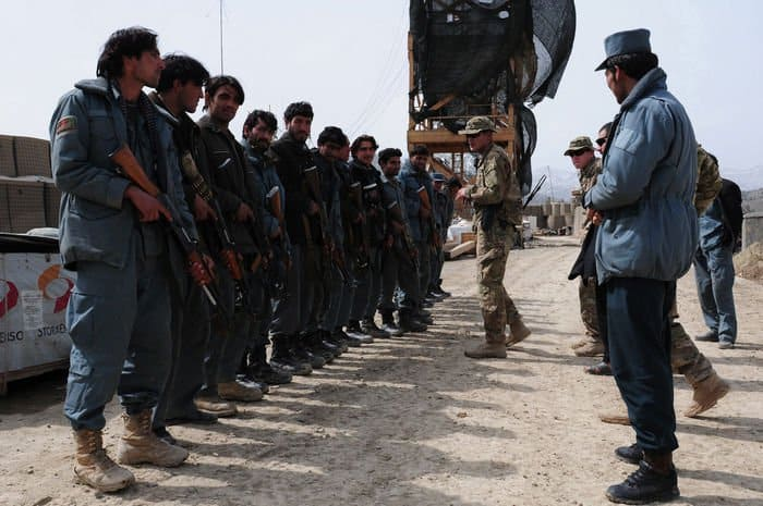 U.S. Army Sgt. Ricardo Mercado, of Philadelphia, a Military Policeman with the 554th Military Police Company delivers instructions to Afghan Uniformed Police in an IED awareness class at Combat Outpost Zerok.