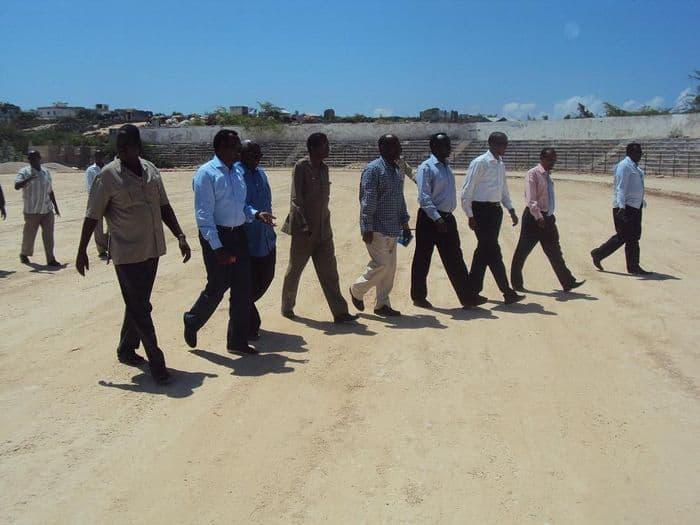 officials walking inside the field