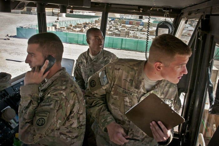 U.S. Army Specialists David Hamilton, Quentin Bradford, and Spencer Smith, air traffic control specialists for 3rd Battalion, 82nd Combat Aviation Brigade, Task Force Corsair, conduct aircraft movement on their flight line on FOB Shank.