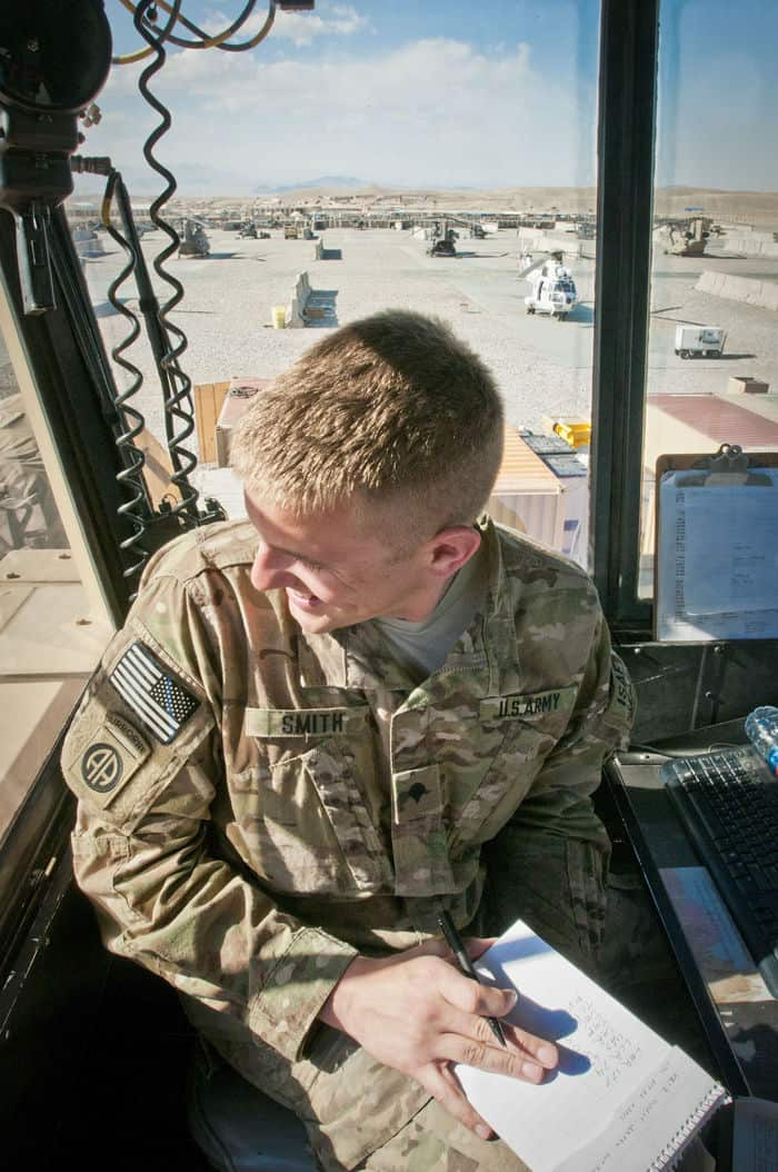 U.S. Army Spc. Spencer Smith, from Monument, Colo., an air traffic control specialist for 3rd Battalion, 82nd Combat Aviation Brigade, Task Force Corsair, watches his flight line on FOB Shank.
