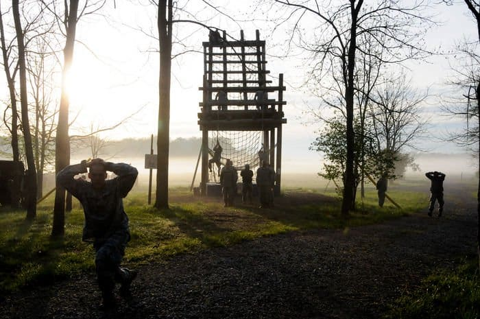 Soldiers perform callisthenic exercises between obstacles in the confidence course portion on zero day of an Air Assault Course at Camp Atterbury.