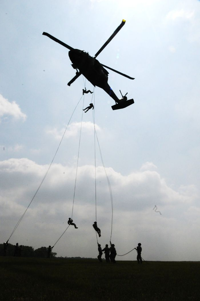 In the final event of the rappelling portion of the Air Assault Course at Camp Atterbury Joint Maneuver Training Center, students rappelled out of a UH 60 Blackhawk helicopter from 90 feet in the air.