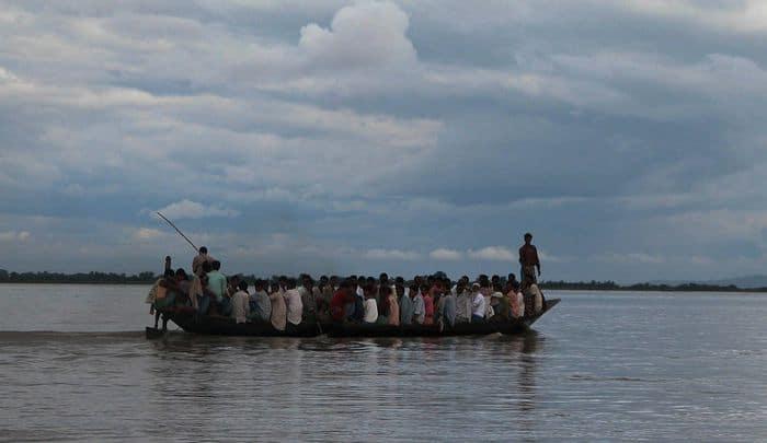 Overcrowded Bhutbhutti speedboat in the Brahmaputra river