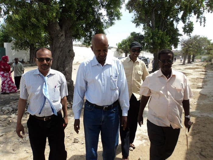 Somali National Olympic committee walk to a sporting facility in Mogadishu.