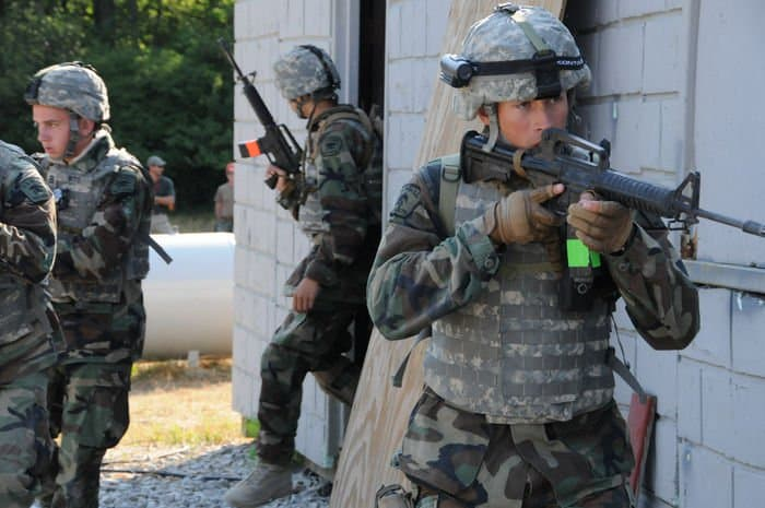 Sea Cadet Josh Witte, of Indianapolis, leads his team through a simulated village assault in Urban Counterinsurgency Training.