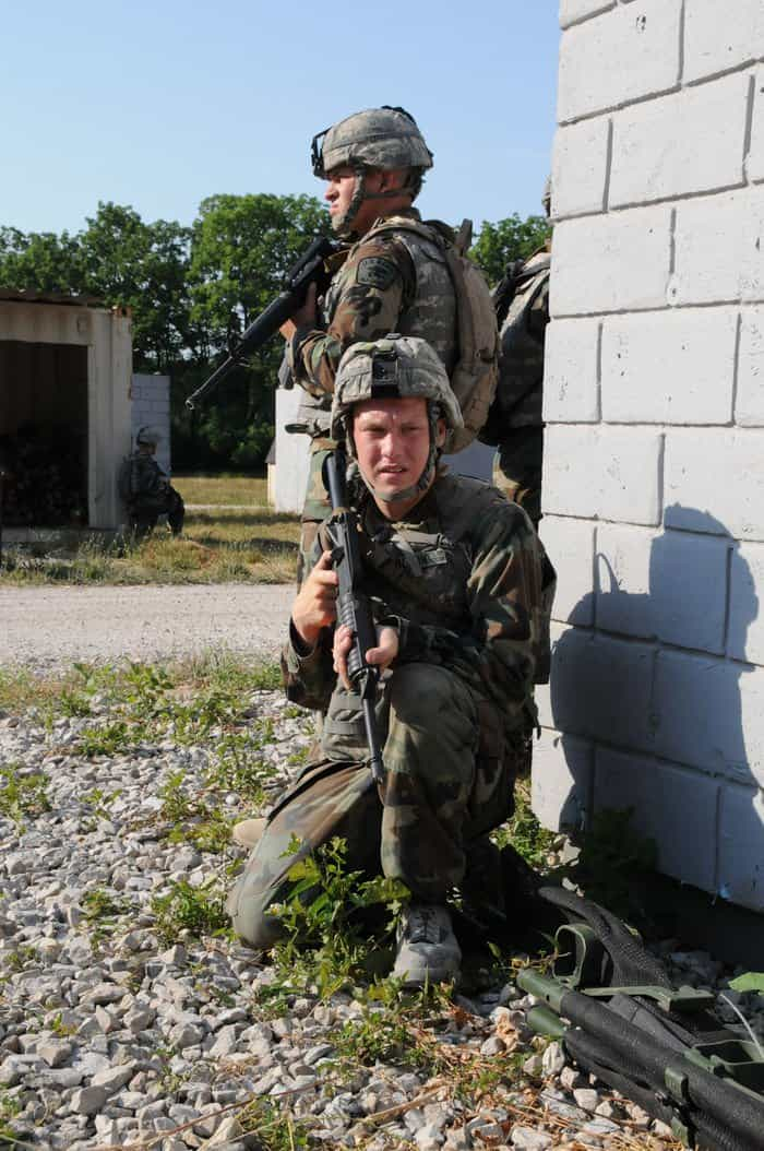Sea Cadets Tyler Olson, of Polaris, Minn. (front), and Kevin Cassidy of Indianapolis, provide security as their team searches buildings in a simulated village assault in Urban Counterinsurgency Training.