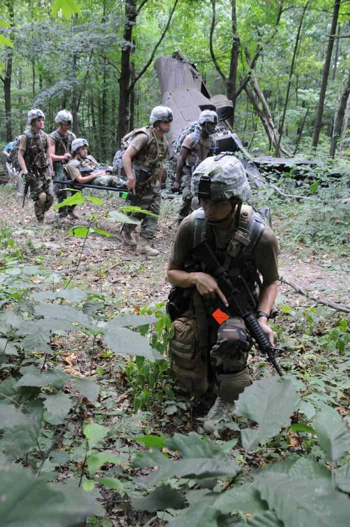 Sea Cadet Jacob Hinsley, of Knoxville, Tenn., maintains security while the rest of his team evacuates a simulated casualty from the scene of a helicopter crash.