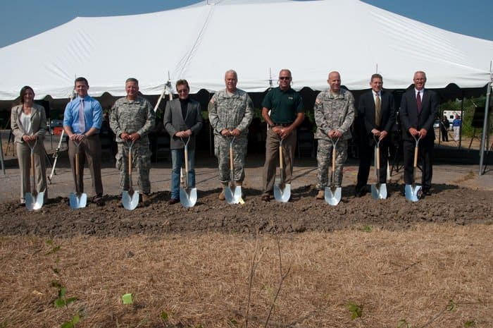 April Dowdle, president CSO Construction Group, Andrew Norris, director of intergovernmental affairs, Maj. Gen. O. Clif Tooley, commander Atterbury Muscatatuck Center for Complex Operations, Stephen Chancellor, CEO of the American Patriot Group and chairman of AmeriQual Group, Maj. Gen. R. Martin Umbarger, Adjutant General Indiana National Guard, Robert Carter, director Indiana Department of Natural Resources, Col. Ivan Denton, Camp Attrebury garrison commander, Matt Barnes, vice president Hunt Construction Group and Rick Conner, president of American Structurepoint, break ground at Camp Atterbury.