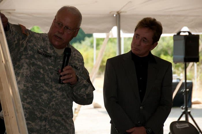 Maj. Gen. R. Martin Umbarger, Adjutant General Indiana National Guard, points out to Stephen Chancellor, CEO of American Patriot Group and chairman of AmeriQual Group, the street named in his honor at a groundbreaking ceremony for the new Operational Readiness Training Complexes.