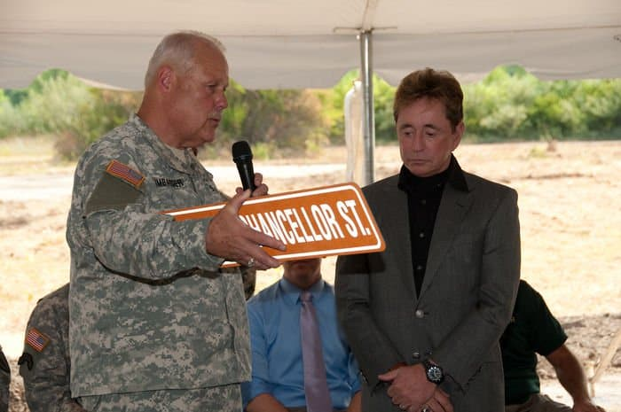 Maj. Gen. R. Martin Umbarger, Adjutant General Indiana National Guard, presents Stephen Chancellor, CEO of American Patriot Group and chairman of AmeriQual Group, with a sign for the street named in his honor, at a groundbreaking ceremony for the new Operational Readiness Training Complexes at Camp Atterbury Joint Maneuver Training Center, Ind.
