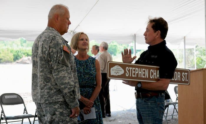 Maj Gen. Martin Umbarger, Adjutant General Indiana National Guard, and his wife Rowana, talk with Stephen Chancellor, CEO, American Patriot Group, Chairman AmeriQual after the new street name had been revealed honoring Chancellor at a groundbreaking ceremony for the construction of new Operational Readiness Training Complexes at Camp Atterbury Joint Maneuver Training Center, Ind.