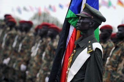 After a century of war, an officer of the Republic of South Sudan holds the new nation's flag during the historic Independence Ceremony. UN Photo