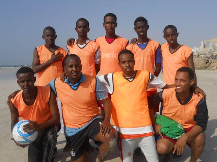 Nine soccer players at the Wiish Academy.