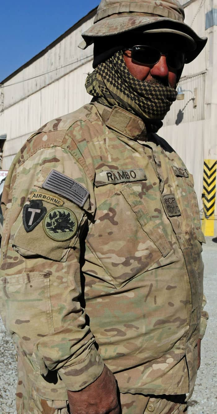 Rambo, a local national and hero to U.S. Soldiers poses while wearing the combat patches of the units he has served side by side in Kabul guarding Camp Phoenix from terrorist attacks.