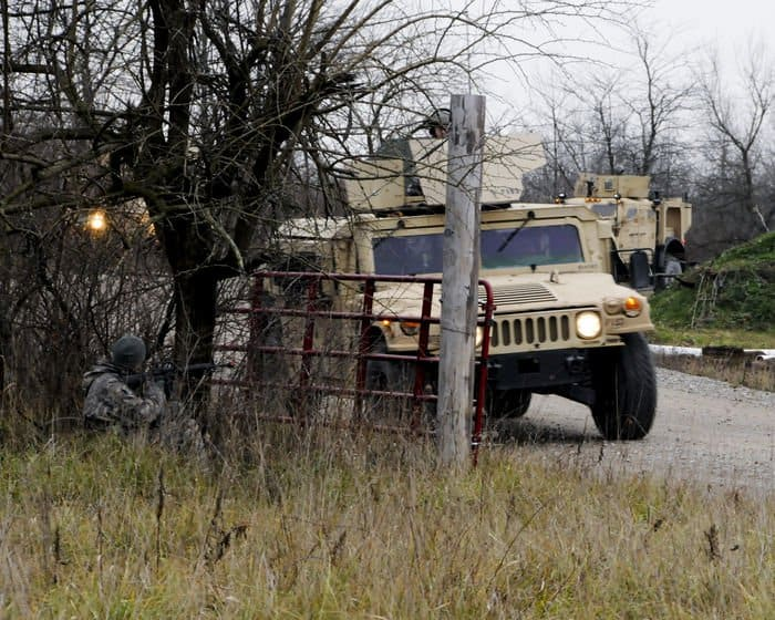 A Soldier with the Indiana Army National Guard 1438th Transportation Co., prepares to attack an oncoming convoy as part of a training mission designed to improve gunner reaction times at Camp Atterbury Joint Maneuver Training Center in Edinburgh, Ind.