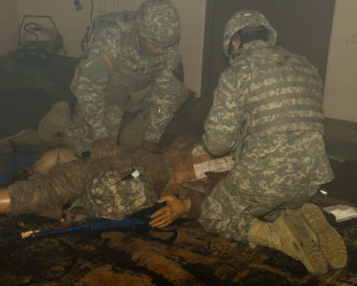 Staff Sgt. Ronald Smith and Pvt. Randy Teepe with the 1438th Transportation Co., participate in combat lifesaver training at the Medical Simulation Training Center at Camp Atterbury Joint Maneuver Training Center in Edinburgh, Ind.