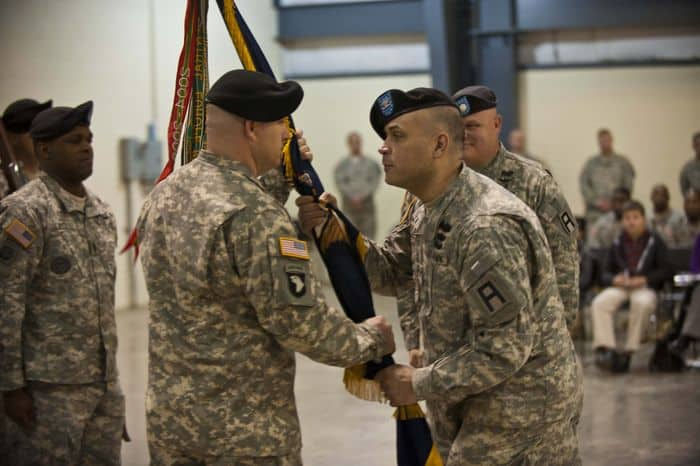 Lt. Col. Jeremy E. Jelly, incoming commander for the 1st Battalion, 335th Infantry Regiment, receives the regimental colors of the 1 335th from Col. John F. Dunleavy, commander of the 205th Infantry Brigade, First Army Division East, at the 1 335th Infantry Regiment Change of Command ceremony.