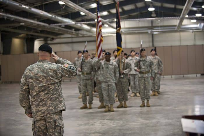 Lt. Col. Jeremy E. Jelly, the new commander of the 1st Battalion, 335th Infantry Regiment, 205th Infantry Brigade, First Army Division East, returns the salute of Command Sgt. Maj. David R. Pitt, command sergeant major of the 1 335th, the Battalion Color Guard Team, and the Warrior Soldiers in formation at the battalion Change of Command ceremony between Jelly and Lt. Col. Craig S. Wagoner, at Camp Atterbury Joint Maneuver Training Center, Ind.
