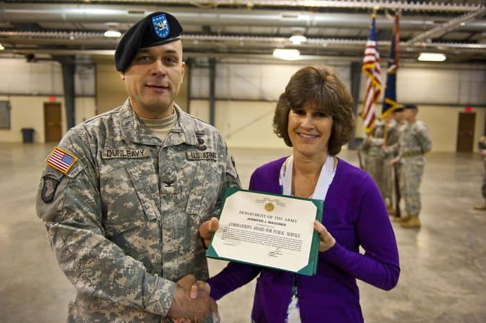 Jennifer J. Wagoner, wife of Lt. Col. Craig S. Wagoner, the outgoing commander of the 1st Battalion, 335th Infantry Regiment, poses with Col. John F. Dunleavy, commander of the 205th Infantry Brigade, First Army Division East, after receiving the Commander Award for Public Service, for her volunteer services, Family Readiness contributions, and cumulative career efforts as an Army wife, before the start of the Change of Command ceremony at Camp Atterbury Joint Maneuver Training Center, Ind.