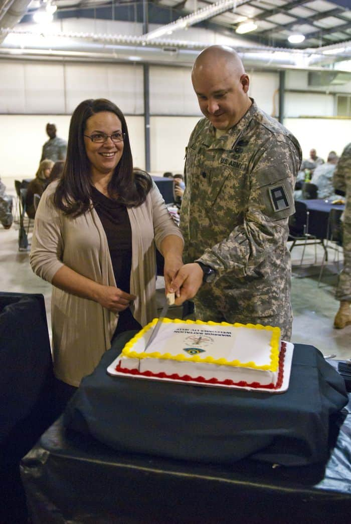 Lt. Col. Jeremy E. Jelly, the new commander of the 1st Battalion, 335th Infantry Regiment, 205th Infantry Brigade, First Army Division East, and his wife, Zoey, cut the cake following the Change of Command ceremony at Camp Atterbury Joint Maneuver Training Center, Ind.