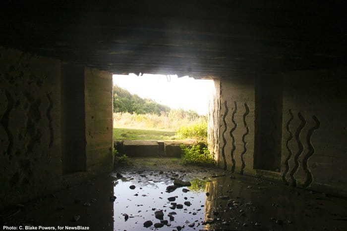 a view to kill, from inside a German gun emplacement at Omaha Beach, Normandy, France