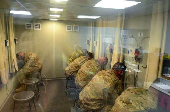 Soldiers of the 5 19th Agribusiness Development Team, Indiana Army National Guard, take a hearing test as part of in processing after returning from their deployment to Afghanistan.