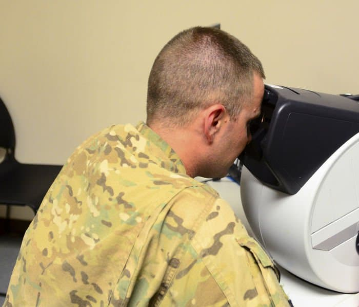 Sgt Jerrod Rybolt, 5 19th Agribusiness Development Team, Indiana Army National Guard, has his vision checked as part of returning from deployment in Afghanistan.
