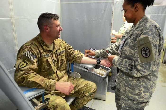 Capt. Robert Skomp, 5 19th Agribusiness Development Team, Indiana Army National Guard, receives a post deployment Tuberculosis test as part of his medical screening after returning from Afghanistan.