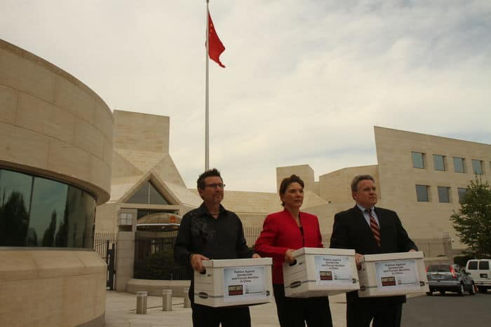 Davis, Littlejohn and Smith in front of Chinese Embassy